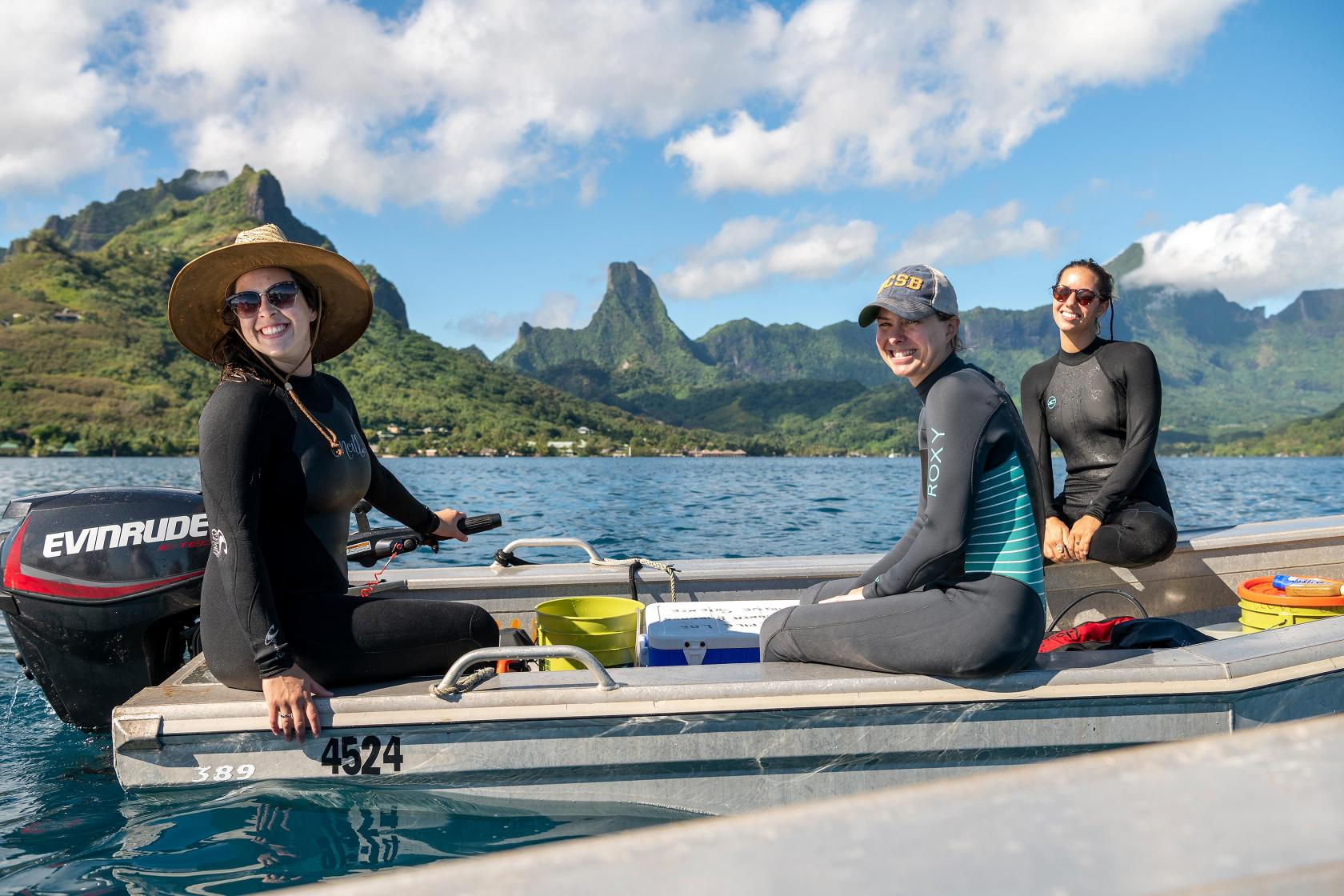 Two student researchers on motorboat in Moorea